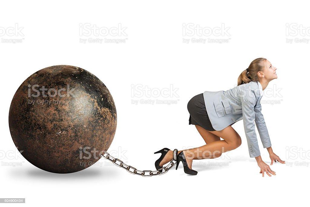 Businesswoman with iron ball stock photo