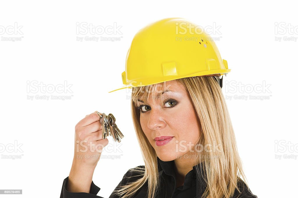 businesswoman with keys royalty free stockfoto