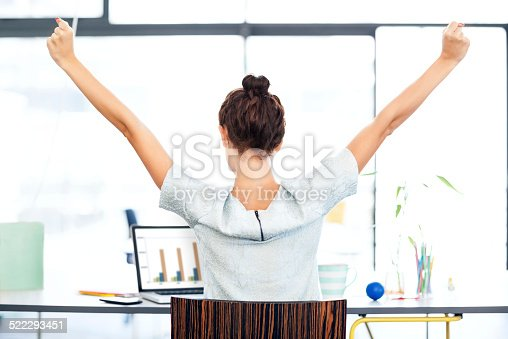 istock Businesswoman With Laptop Celebrating Success At Office Desk 522293451