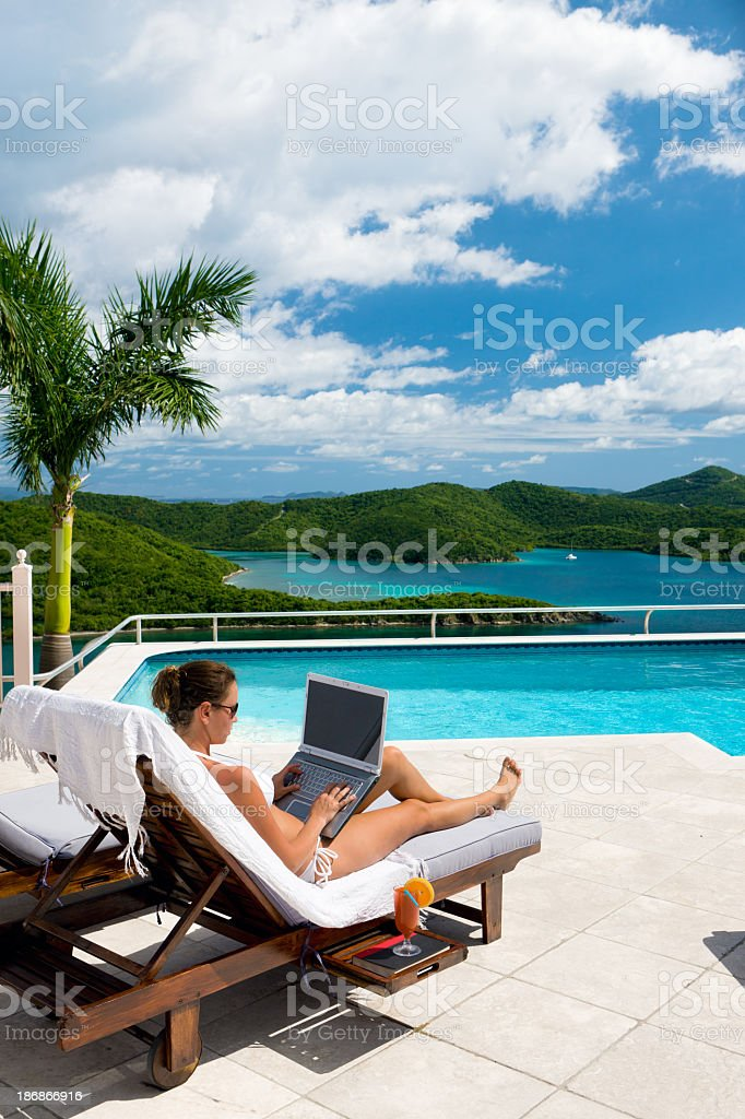 businesswoman with laptop enjoying luxury vacation in the Caribbean royalty-free stock photo