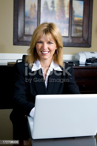 981750034 istock photo Businesswoman with Laptop in Office 172708005
