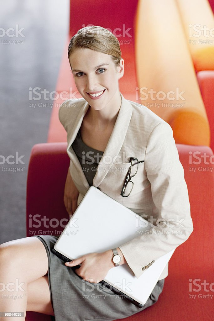 Businesswoman with laptop in waiting area royalty-free stock photo