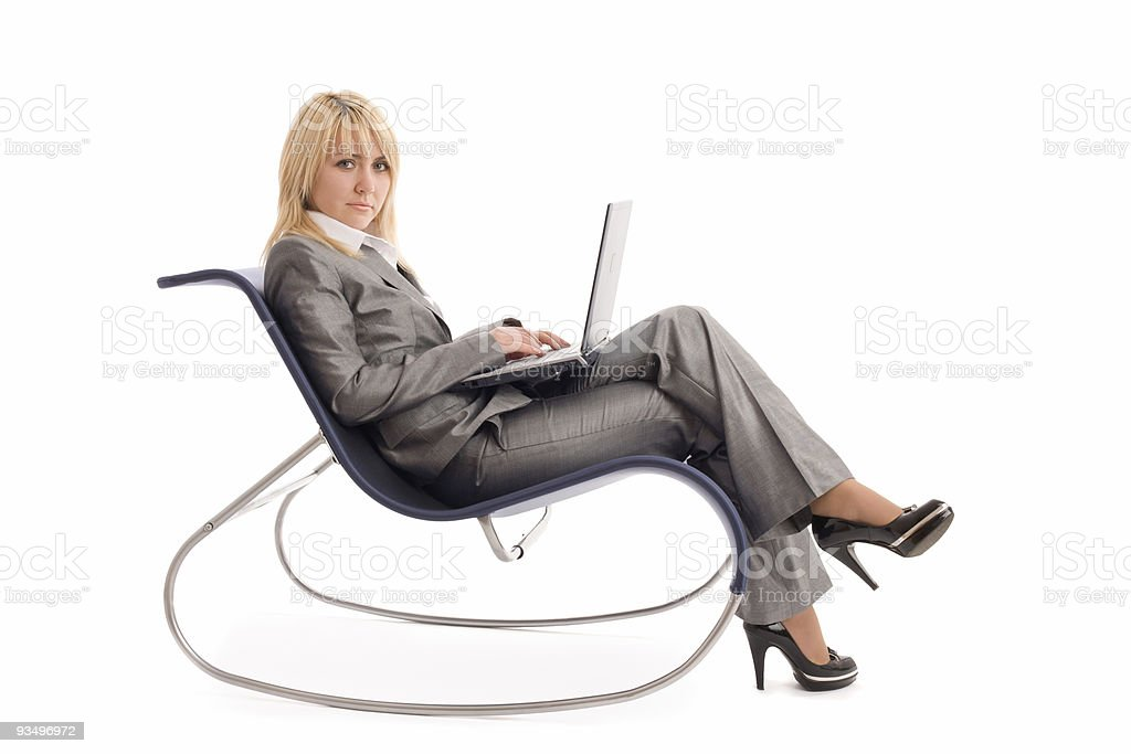 Businesswoman with laptop rest in chair over white royalty-free stock photo