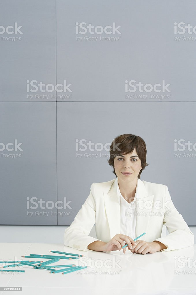 Businesswoman with large number of blue pencils royalty free stockfoto