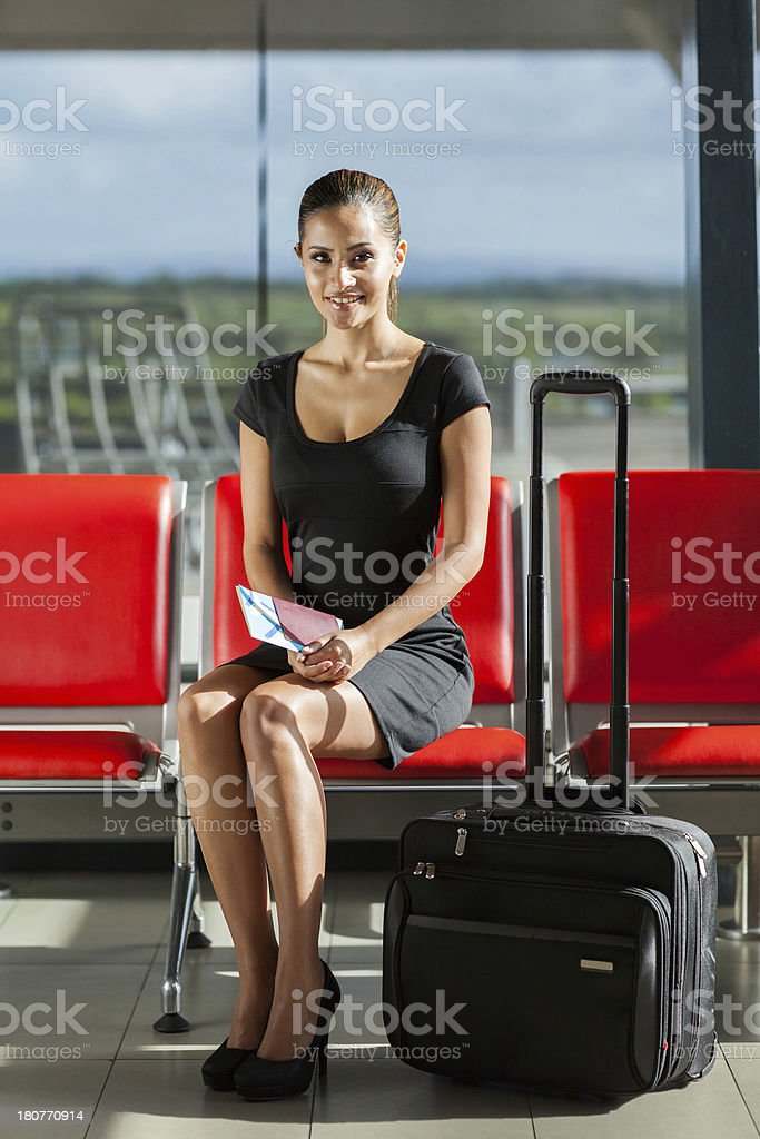 businesswoman with luggage waiting at airport royalty-free stock photo