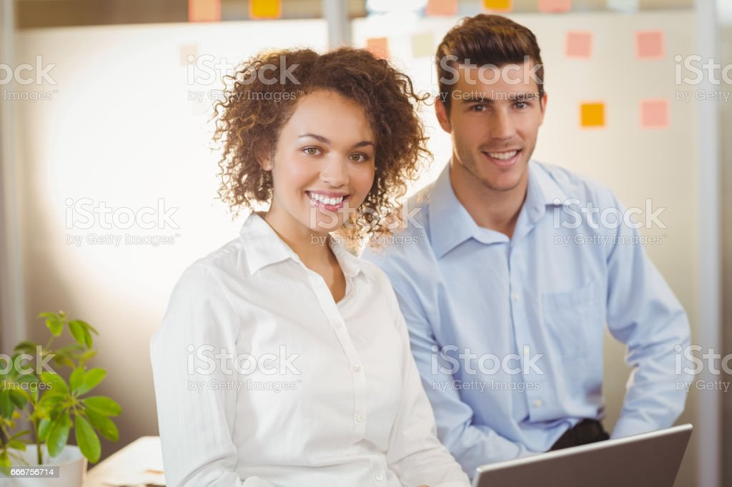 Businesswoman with male colleague foto stock royalty-free