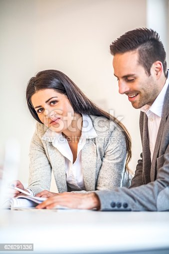 496441730 istock photo Businesswoman with male colleague working at desk in office 626291336