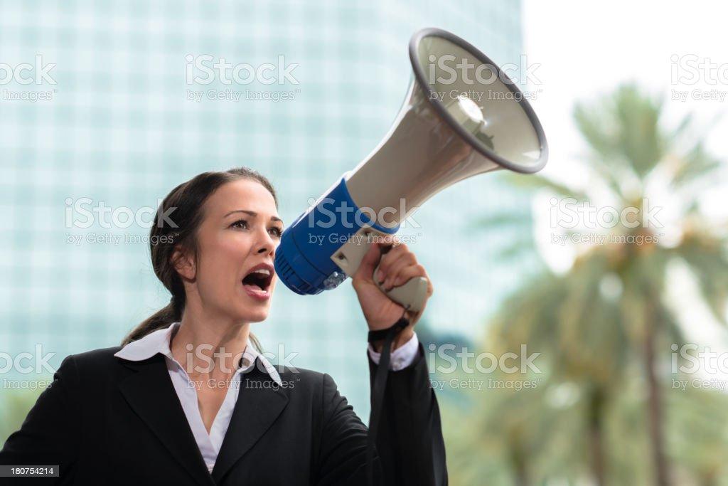 Businesswoman with Megaphone Bullhorn stock photo
