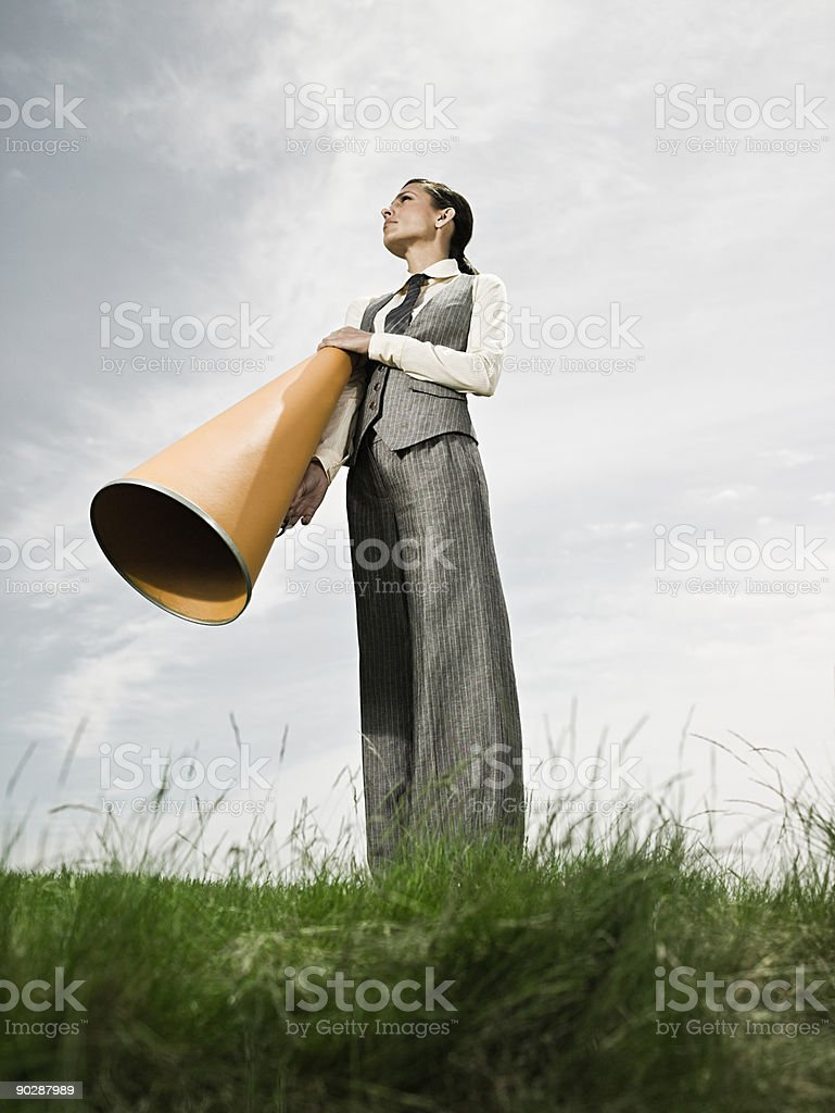 Businesswoman with megaphone stock photo