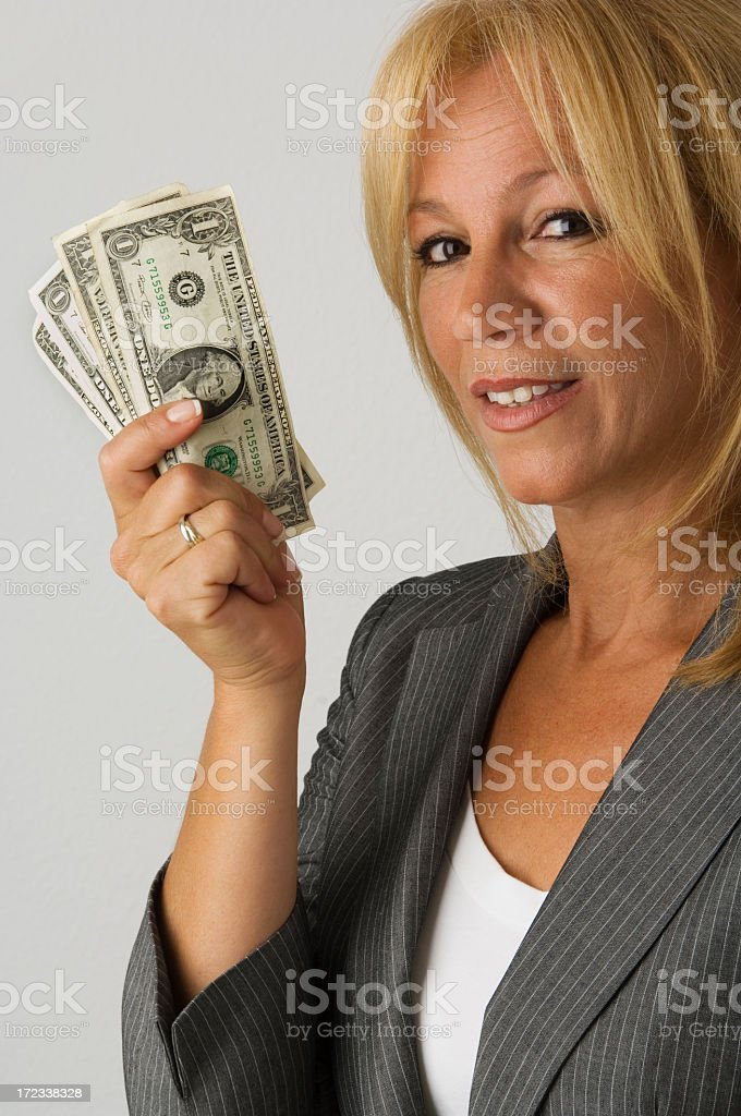 Businesswoman with money royalty-free stock photo