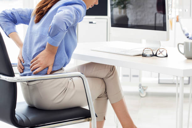 businesswoman with pain in back - sitting stock pictures, royalty-free photos & images