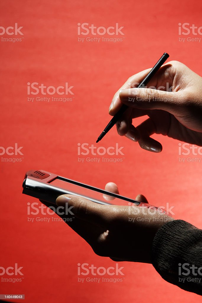 Businesswoman with PDA royalty-free stock photo