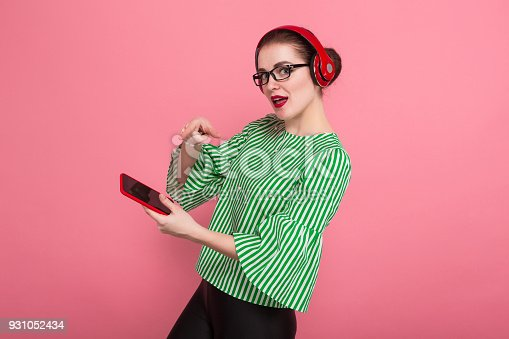 istock Businesswoman with phone and earphones 931052434