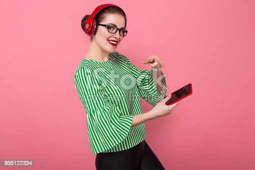 istock Businesswoman with phone and earphones 935122334
