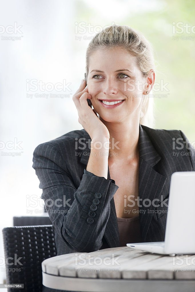 Businesswoman with Phone and Laptop royalty-free stock photo