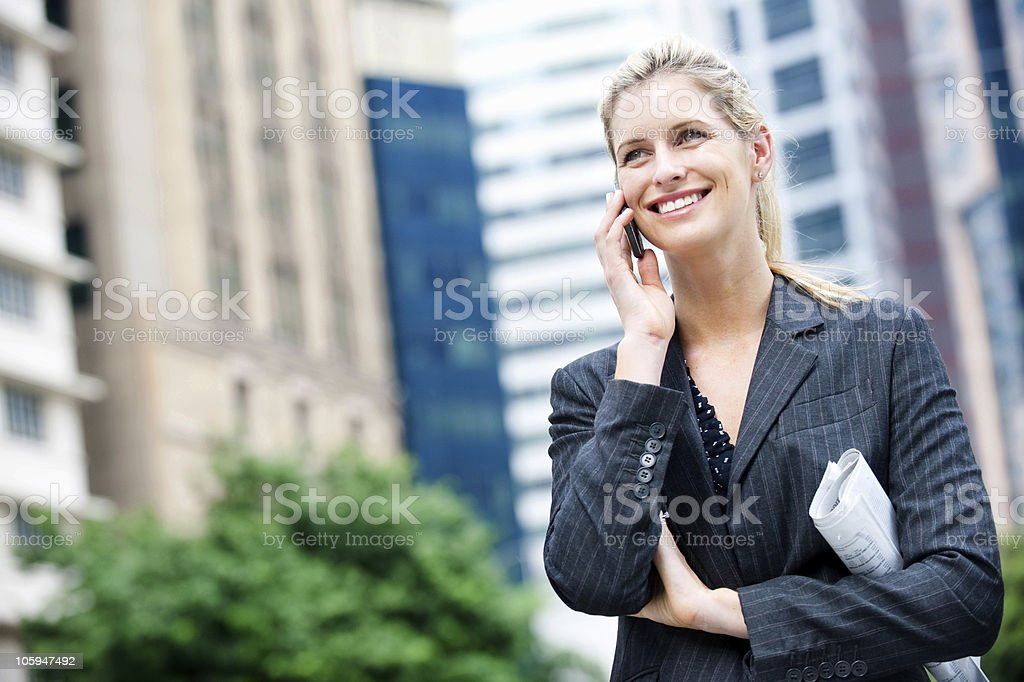 Businesswoman with Phone and Newspapers royalty-free stock photo