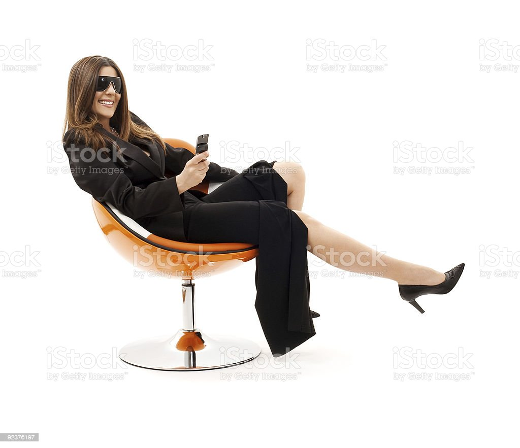 businesswoman with phone in orange chair royalty-free stock photo
