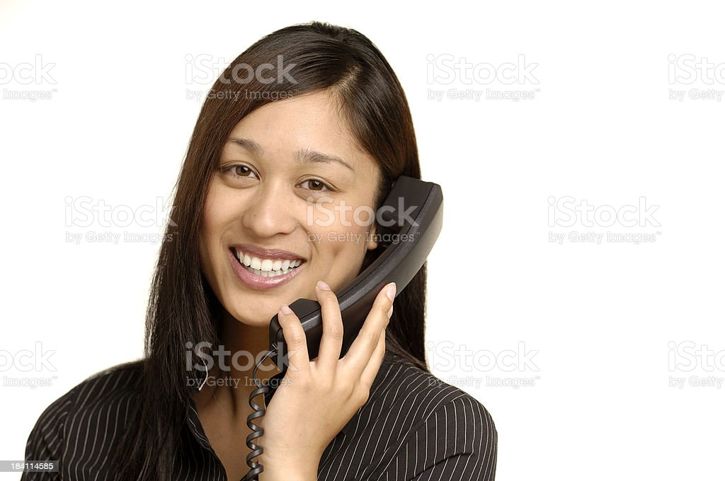 Businesswoman with phone on white stock photo