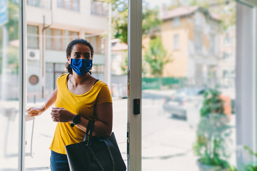 Businesswoman with mask is entering the office,COVID-19 concept