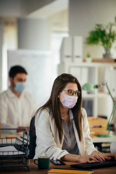 Businesswoman with protective mask stock photo