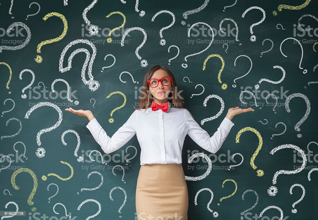 Businesswoman with question mark stock photo