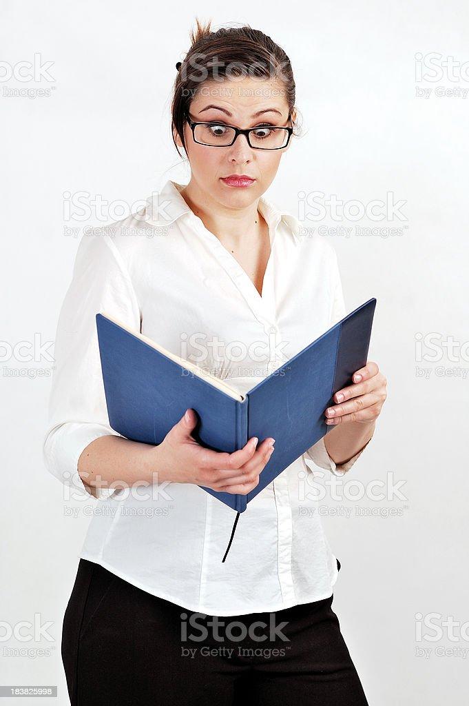 Businesswoman with raised eyebrows stock photo