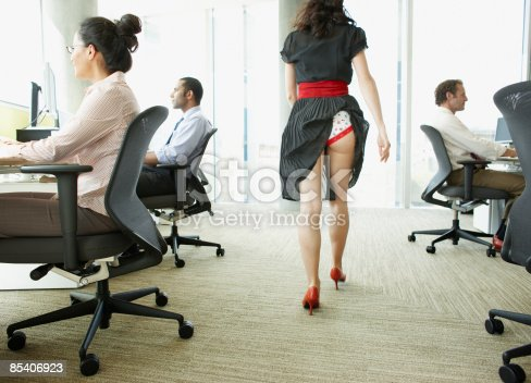 istock Businesswoman with skirt caught in underwear 85406923
