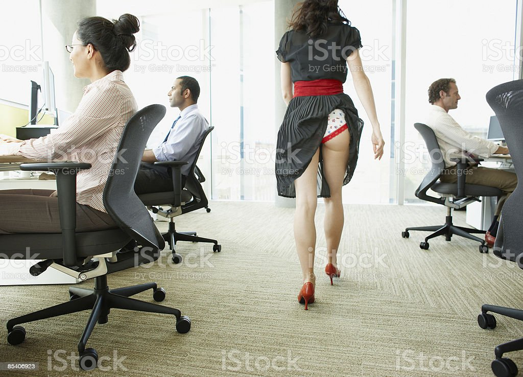 Businesswoman with skirt caught in underwear stock photo