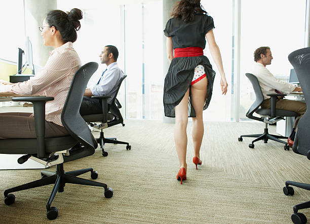 businesswoman with skirt caught in underwear - rear view stock photos and pictures