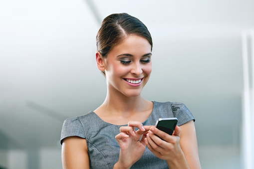 Businesswoman With Smart Phone Stock Photo - Download Image Now