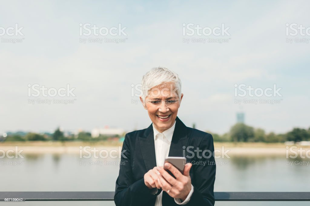 Businesswoman with smart phone stock photo
