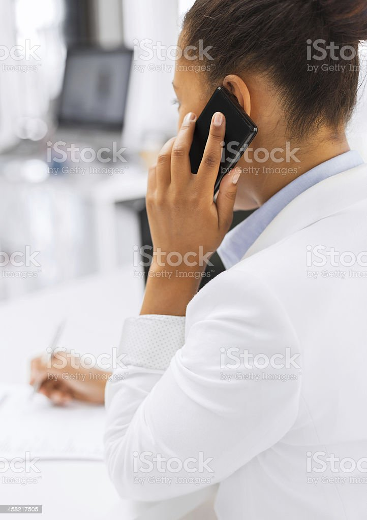 businesswoman with smartphone in office royalty-free stock photo