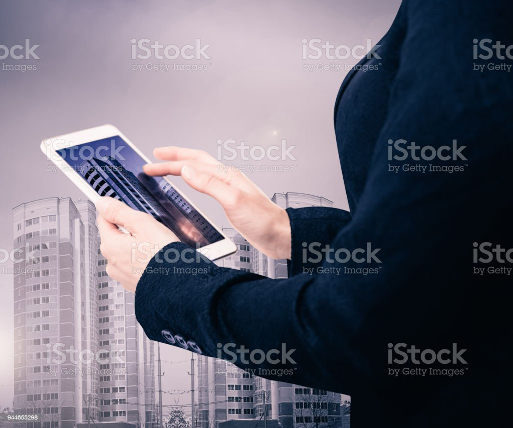 Businesswoman with smartphone on cityscape background stock photo