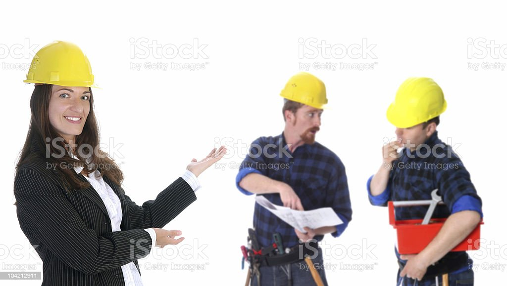 businesswoman with successful construction workers royalty-free stock photo