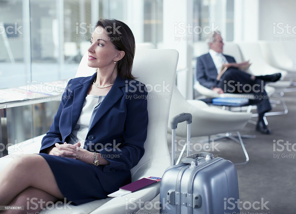 Businesswoman with suitcase waiting in airport royalty-free stock photo