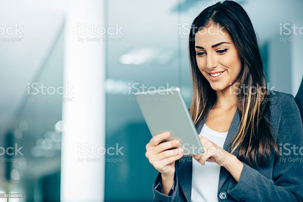 Businesswoman with tablet stock photo