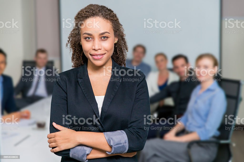 Businesswoman With Team stock photo