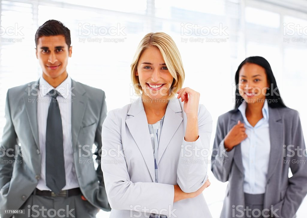 Businesswoman with teammates in background royalty-free stock photo