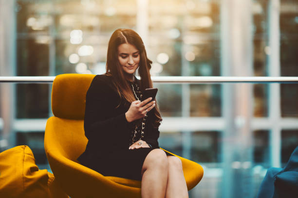 A businesswoman with the cellphone stock photo
