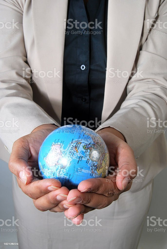 Businesswoman with the globe in her hands royalty-free stock photo