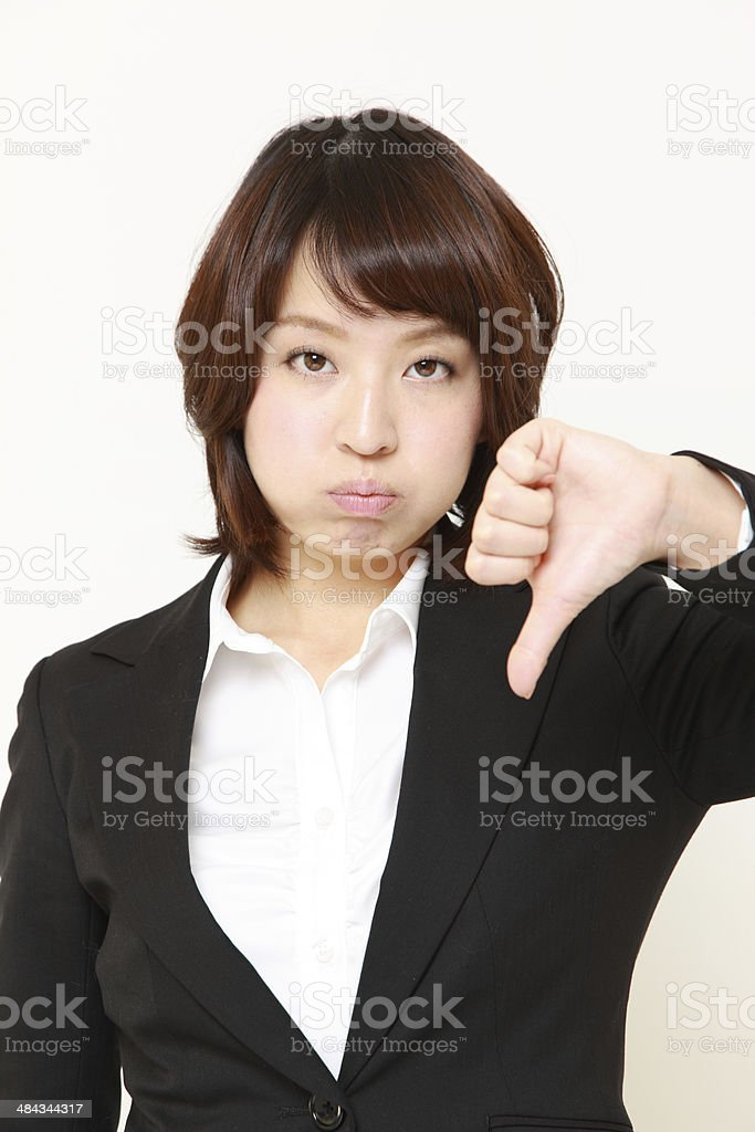 businesswoman with thumbs down gesture stock photo