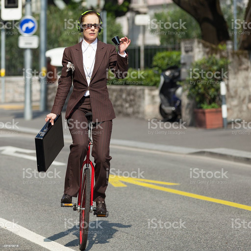 businesswoman with unicycle stock photo