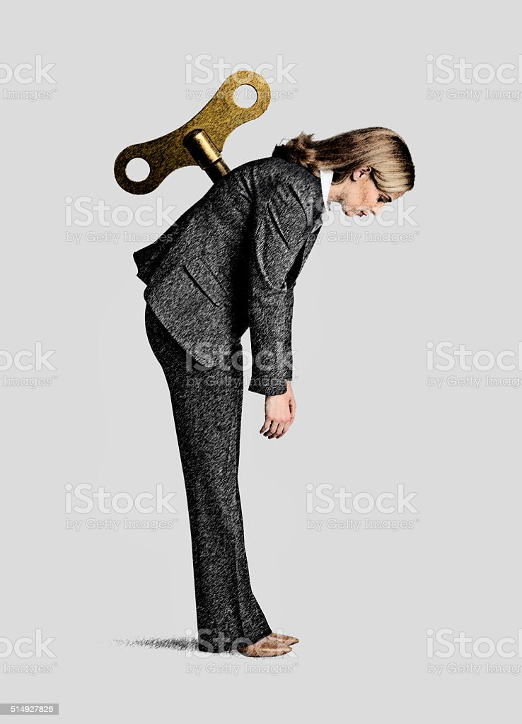 Geschäftsfrau mit Wind-Up-Taste In Ihrem Rücken – Foto
