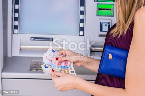 istock Businesswoman Withdrawing And Counting European Currency from at 594073930