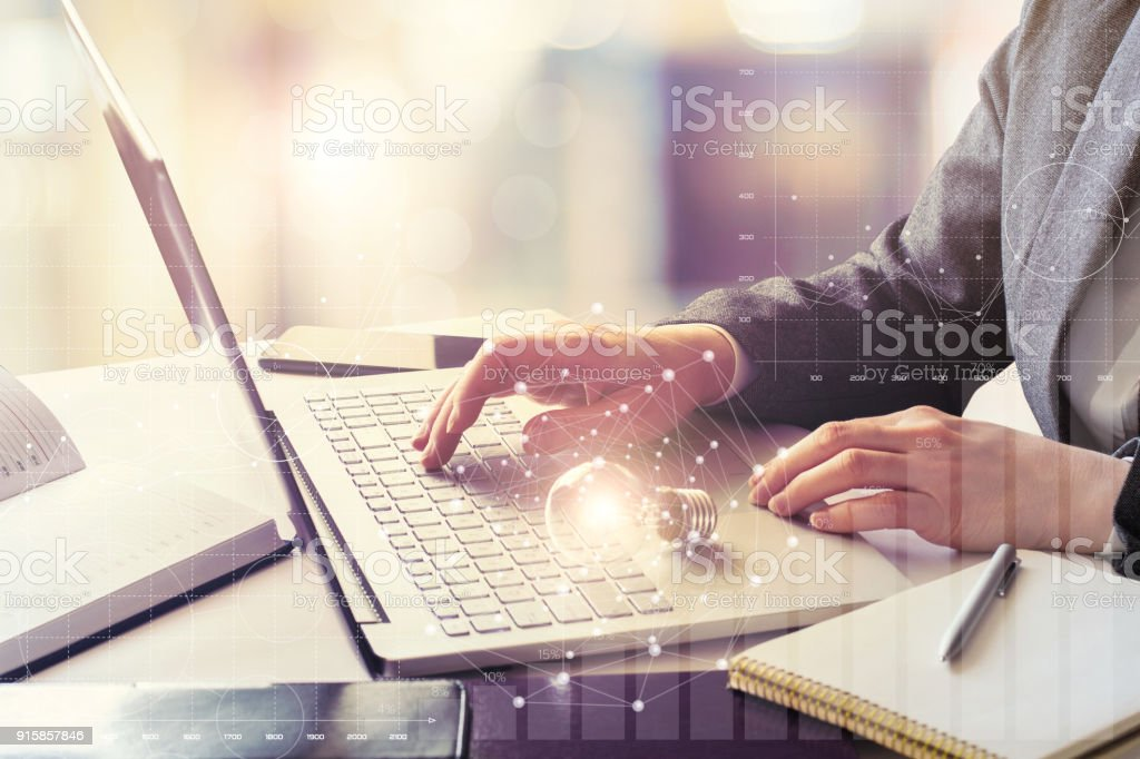 Businesswoman working at a laptop . stock photo