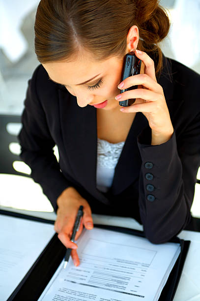 Businesswoman working at a restaurant stock photo