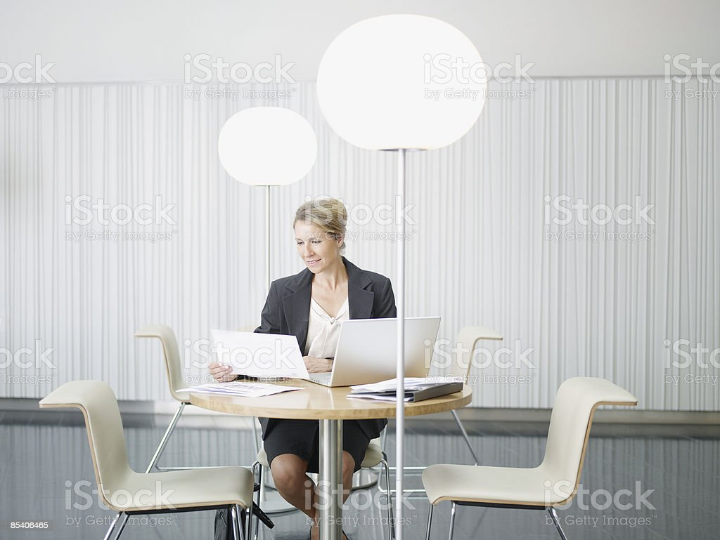 Businesswoman working at cafe table stock photo