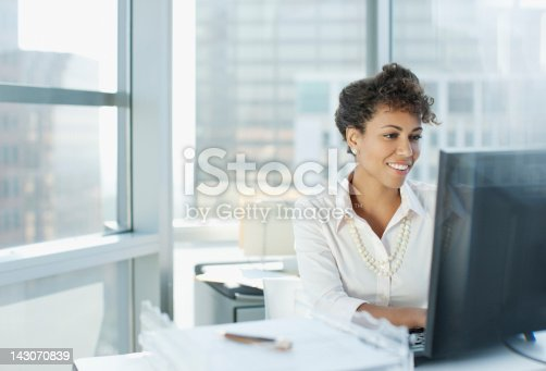 istock Businesswoman working at desk in office 143070839