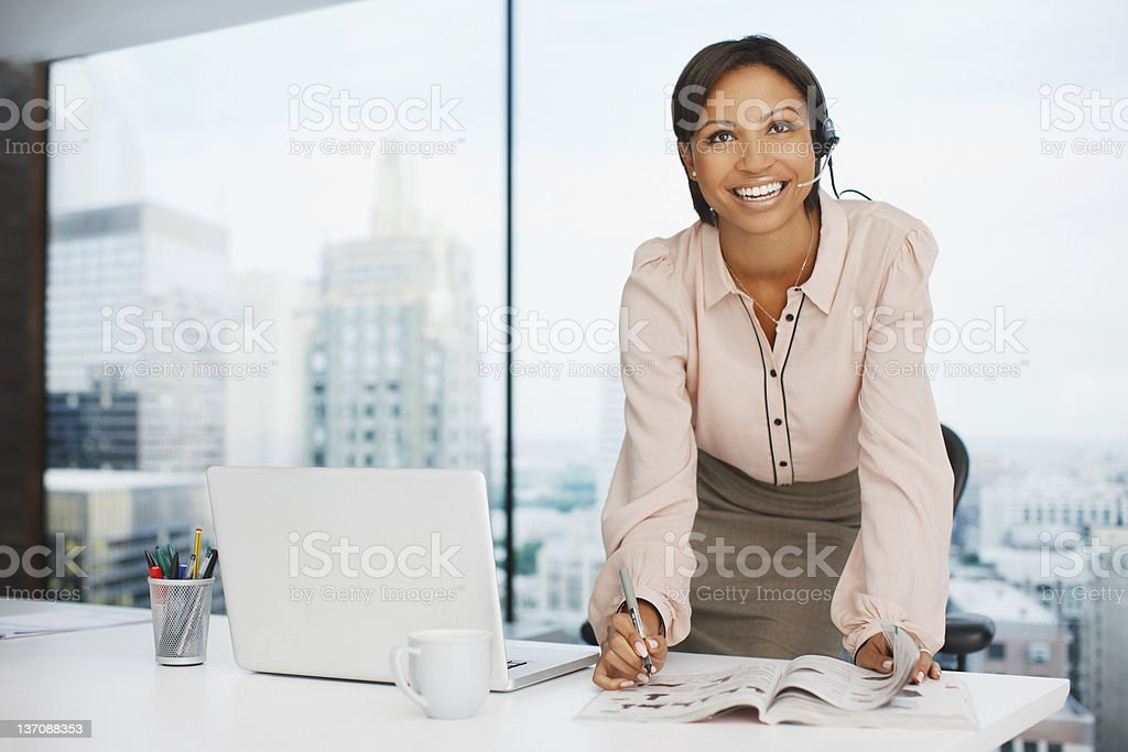 Businesswoman working at desk stock photo