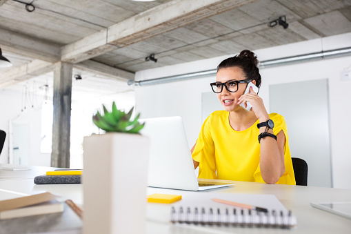 Businesswoman Working At Her Desk Stock Photo - Download Image Now